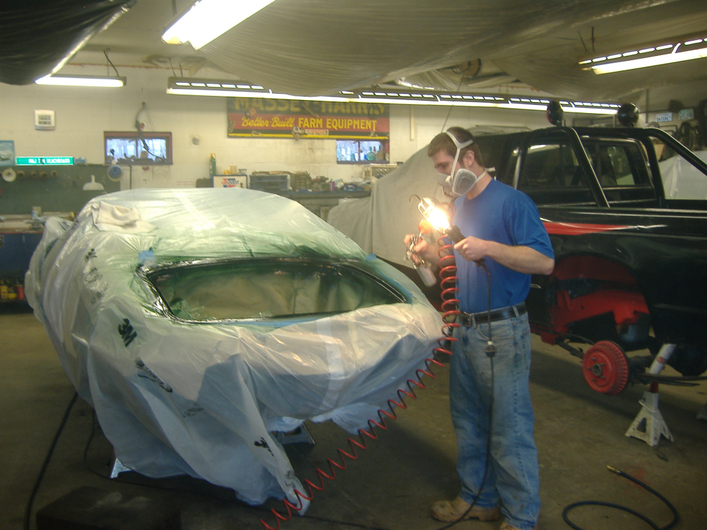 Touch up work on a Jag.